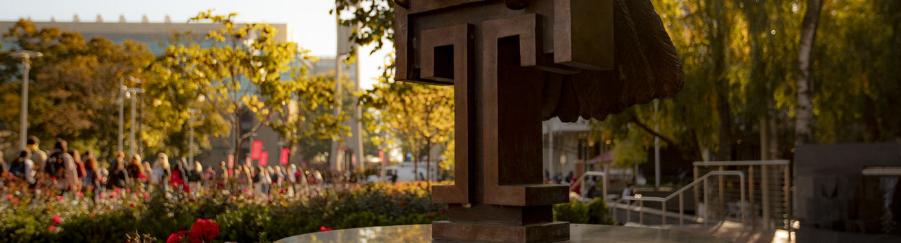 """A Temple """"T"""" found at the base of the owl sculpture in O'Connor Plaza on Main Campus."""
