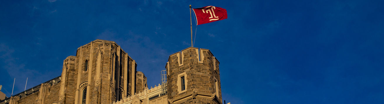 A Temple banner flying above Mitten Hall.