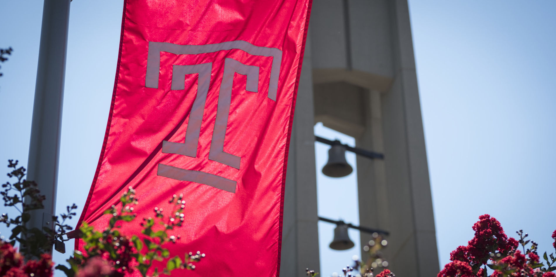 A Temple flag flying in front of the Bell Tower.